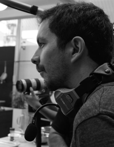 """<b class=""""aboutt1""""> NICOLAS CUELLAR </b> <br> <b class=""""aboutt2""""> Director </b> <br><br> <b class=""""aboutt3""""> Nicolas Cuellar is a film director and editor for social documentary and narrative projects worldwide. He trains local production teams around the world and gives them the tools to tell their own stories. He has developing teams in Haiti, Colombia and NYC. </b> <br><br> <b class=""""aboutt4""""> Through his experience leading both documentary and narrative projects.</b>"""